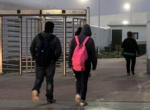 Students in Tijuana walk toward the U.S. border.